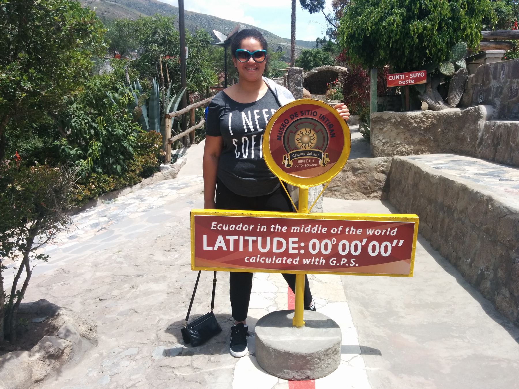 Me behind a sign that says Latitude zero degrees, zero minutes, zero seconds